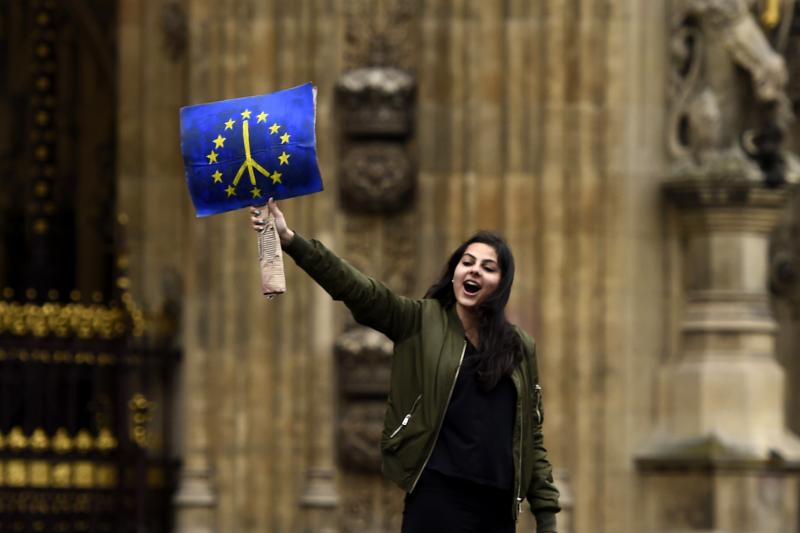 A demonstrator stands outside the Houses of Parliament during a protest aimed at showing London's solidarity with the European Union following the recent EU referendum, in central London, Britain, June 28, 2016.