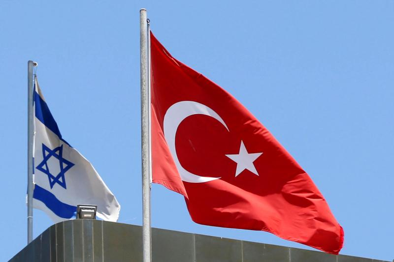 A Turkish flag flutters atop the Turkish embassy as an Israeli flag is seen nearby, in Tel Aviv, Israel June 26, 2016.