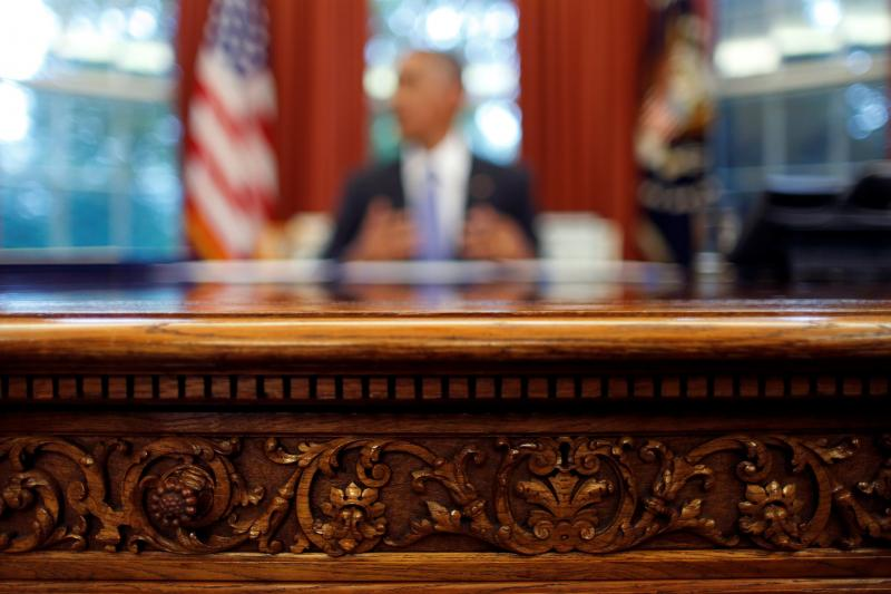 U.S. President Barack Obama's desk is seen as he signs into law S. 337: FOIA Improvement Act of 2016 and S. 2328: Puerto Rico Oversight, Management and Economic Stability Act at the Oval Office of the White House in Washington, U.S., June 30, 2016.