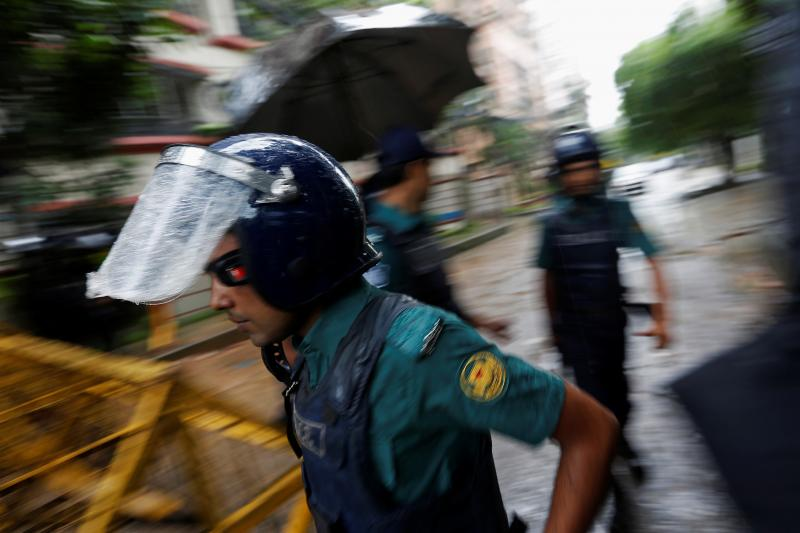 Policemen patrol on the road leading to the Holey Artisan Bakery and the O'Kitchen Restaurant after gunmen attacked, in Dhaka, Bangladesh, July 3, 2016.