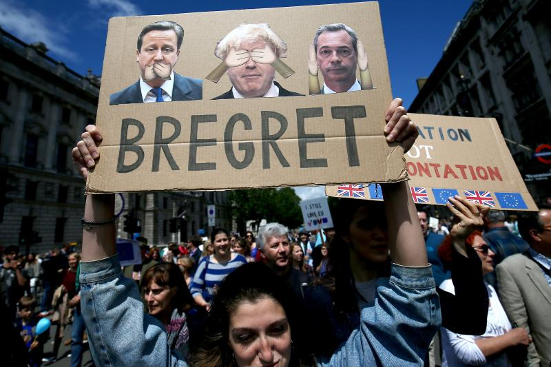 People hold banners during a 'March for Europe' demonstration against Britain's decision to leave the European Union, in central London, Britain July 2, 2016.