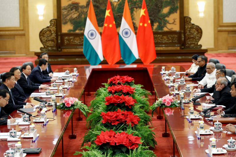 India's President Pranab Mukherjee (2nd R) meets with Chinese President Xi Jinping (2nd L) during a meeting at the Great Hall of the People in Beijing, China, May 26, 2016.