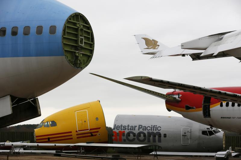 Dismantled planes are seen in the recycling yard of Air Salvage International (ASI) in Kemble, central England November 27, 2013. Following an interim deal over Iran's nuclear activities, Tehran will be allowed limited purchases of aircraft parts