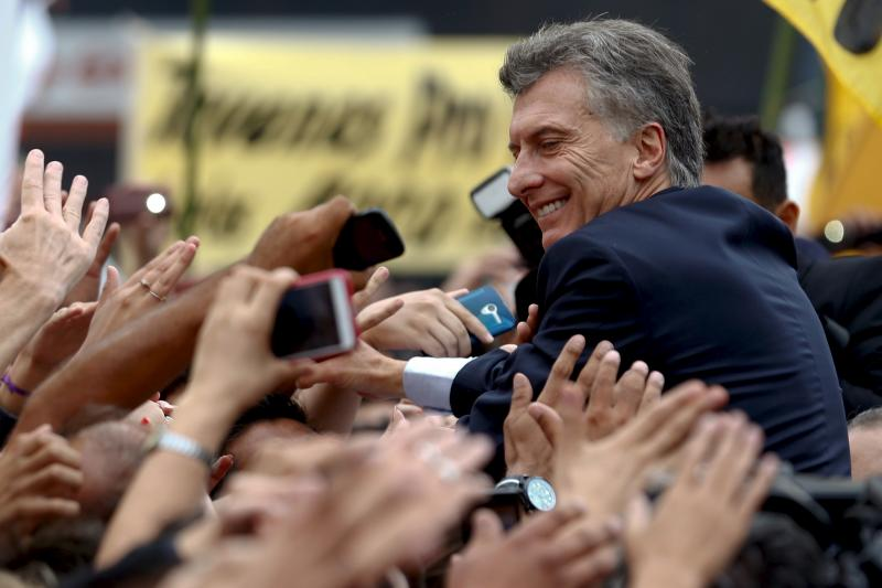 Argentine President Mauricio Macri greets supporters in Buenos Aires, March 2016.