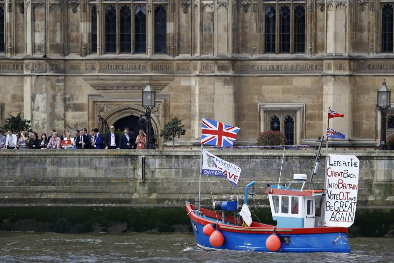 Part of a flotilla of fishing vessels campaigning to leave the European Union sails past Parliament on the river Thames in London, June 15, 2016.