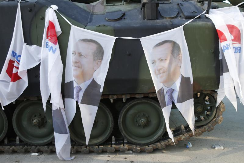 An Armored Vehicle with portraits of Turkish President Tayyip Erdogan is parked outside the parliament building in Ankara, Turkey, July 16, 2016.