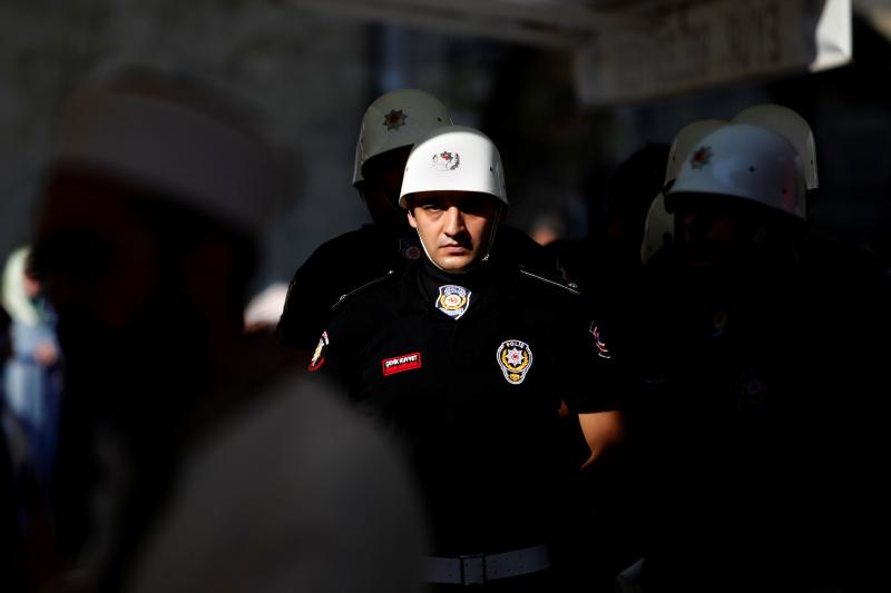 A police officer stands guard during the funeral ceremony of his colleague Erol Ince, who was killed during a thwarted coup at the Eyup Sultan Mosque in Istanbul, Turkey, July 18, 2016.