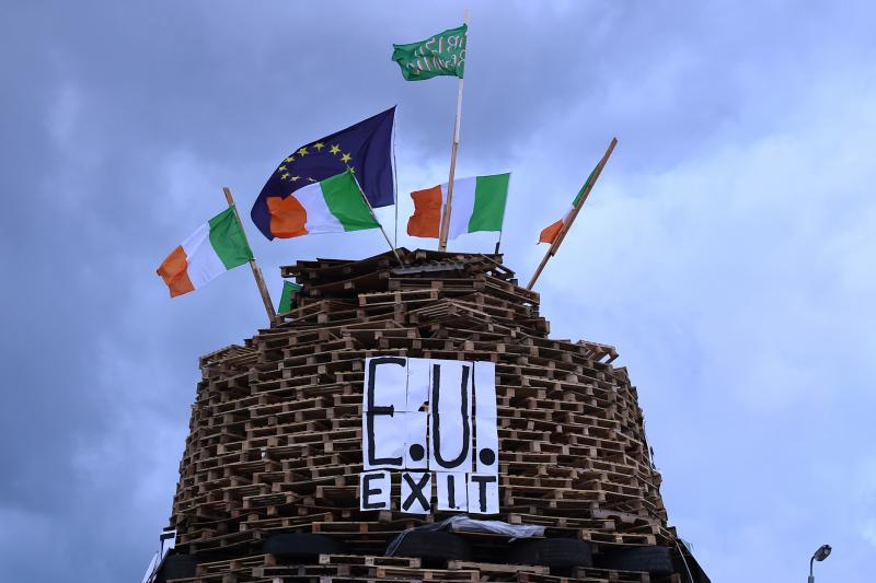 """A bonfire pyre with the words """"EU EXIT"""" is seen in Tiger's Bay ahead of the Twelfth of July celebrations held by members of the Orange Order in Belfast, Northern Ireland, July 11, 2016."""