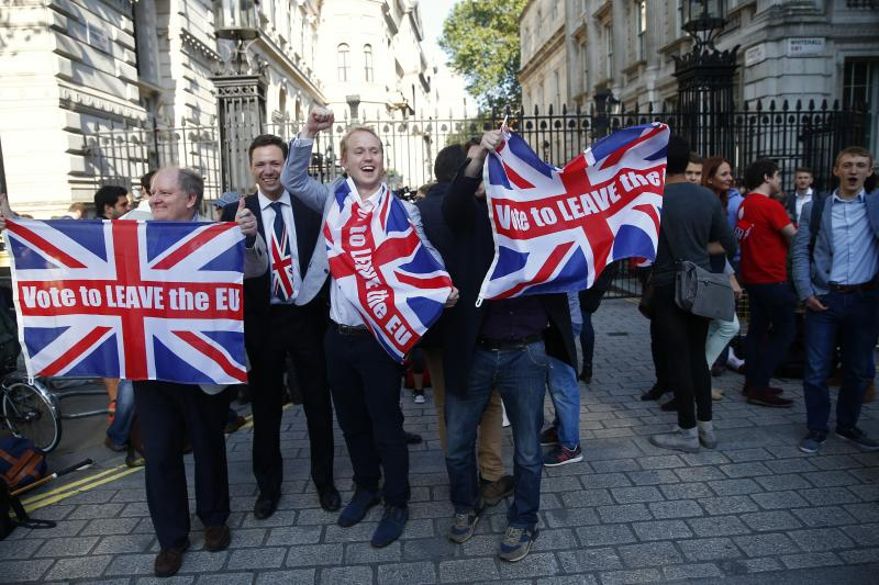 Vote Leave supporters wave Union flags, following the result of the EU referendum, outside Downing Street in London, Britain June 24, 2016.