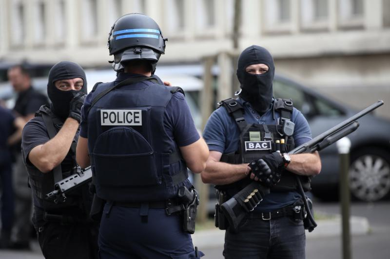 French police and anti-crime brigade (BAC) secure a street they carried out a counter-terrorism swoop at different locations in Argenteuil, a suburb north of Paris, France, July 21, 2016.