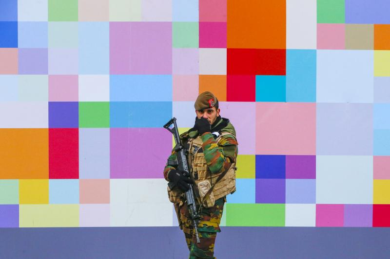 A Belgian soldier patrols a shopping street in central Brussels following the Paris attacks, Belgium, November 2015.