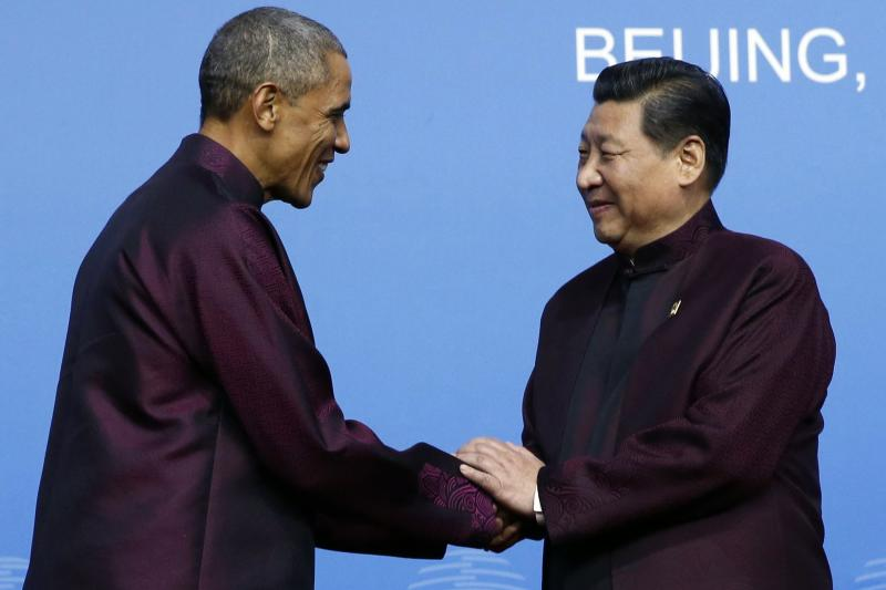 President Obama shakes hands with Xi Jinping in Beijing, November 2014.