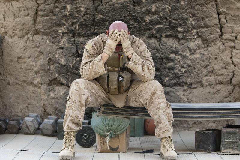 Battle fatigue: a U.S. marine in Helmand Province, Afghanistan, June 2011.