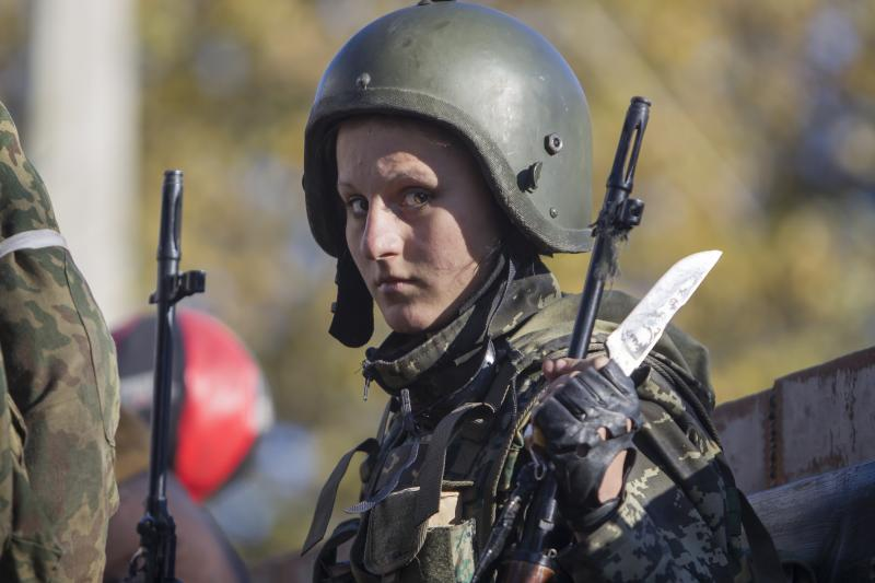 A pro-Russian rebel on the way to the fight with the Ukranian government near Donetsk, October 2014.