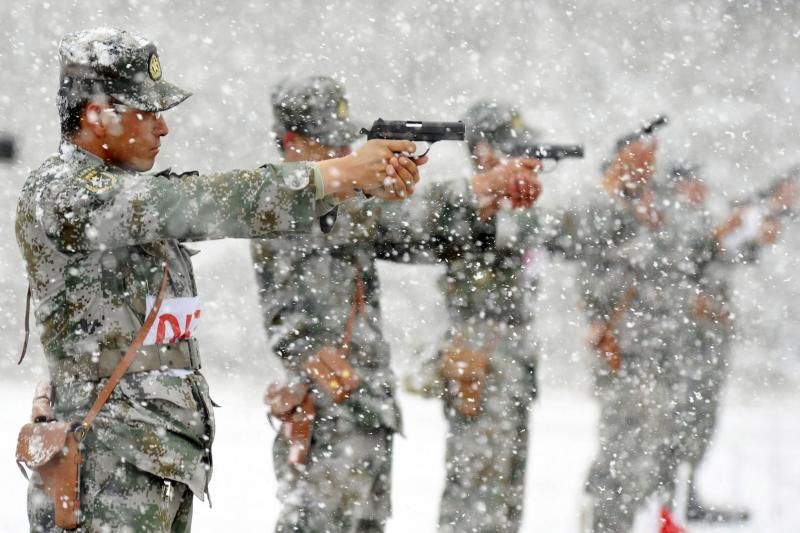 PLA soldiers training at a military base in Uighur Autonomous Region, May 2014.