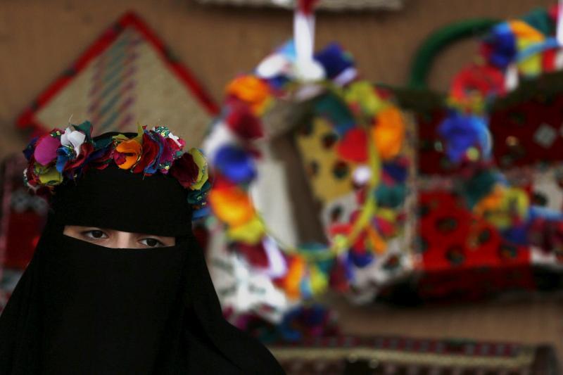 A Saudi woman displays her ornamental products during Janadriyah Culture Festival on the outskirts of Riyadh, Saudi Arabia February 8, 2016.