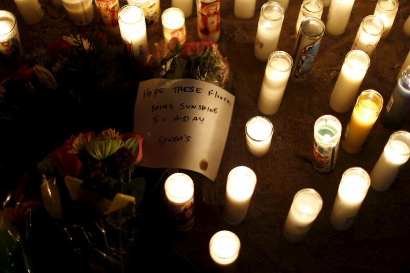 A note is pictured at a pop-up memorial in San Bernardino, California December 4, 2015.