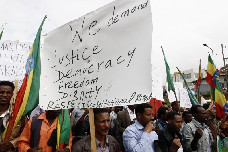 People attend a demonstration organized by opposition party the Ethiopian Federal Democratic Unity Forum (MEDREK) in Ethiopia's capital of Addis Ababa, May 24, 2014.