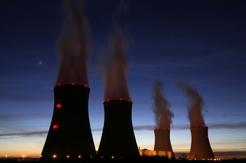 Steam rises at night from the cooling towers of the Electricite de France (EDF) nuclear power station in Dampierre-en-Burly, March 8, 2015.