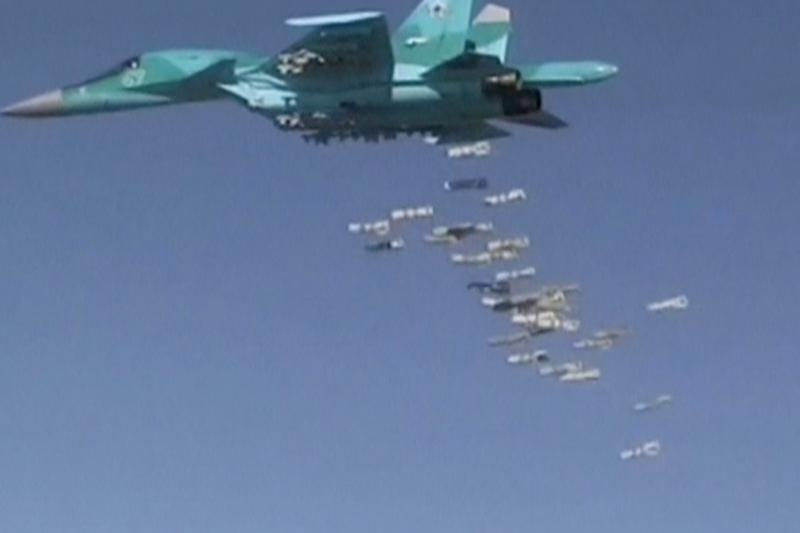 A still image, taken from video footage and released by Russia's Defence Ministry on August 18, 2016, shows a Russian Sukhoi Su-34 fighter-bomber based at Iran's Hamadan air base dropping off bombs in the Syrian province of Deir ez-Zor.