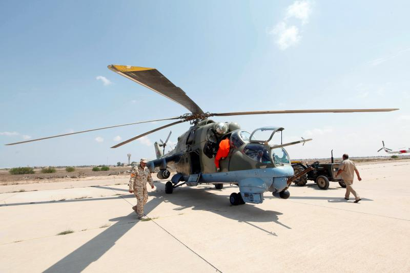 Members of Libyan forces allied with the UN-backed government prepare a renovated Libyan helicopter at Misurata air base, Libya, September 4, 2016.