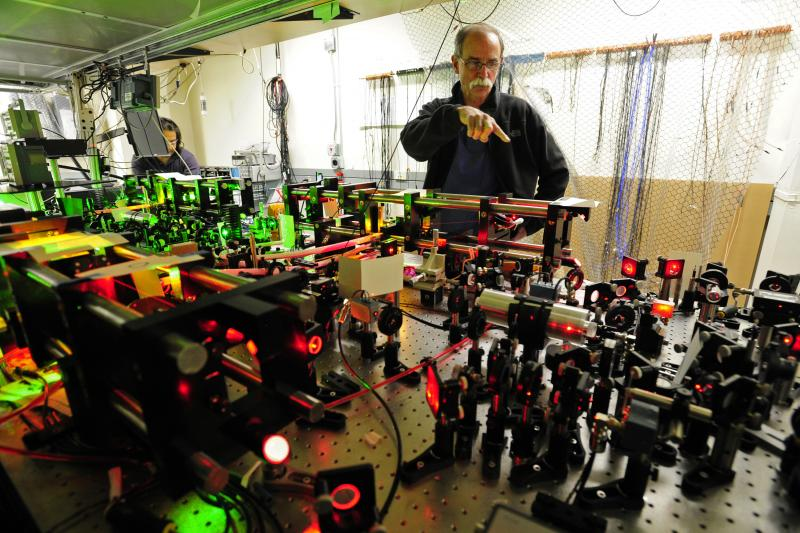 U.S. physicist David Wineland talks about is experiment in his lab during a media tour after a news conference in Boulder, Colorado, after learning he and Serge Haroche of France were awarded the 2012 Nobel Prize in Physics, October 9, 2012.