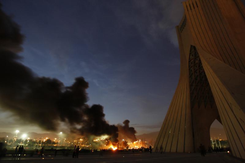 A Basij militia base burns following protests in Tehran, June 2009.
