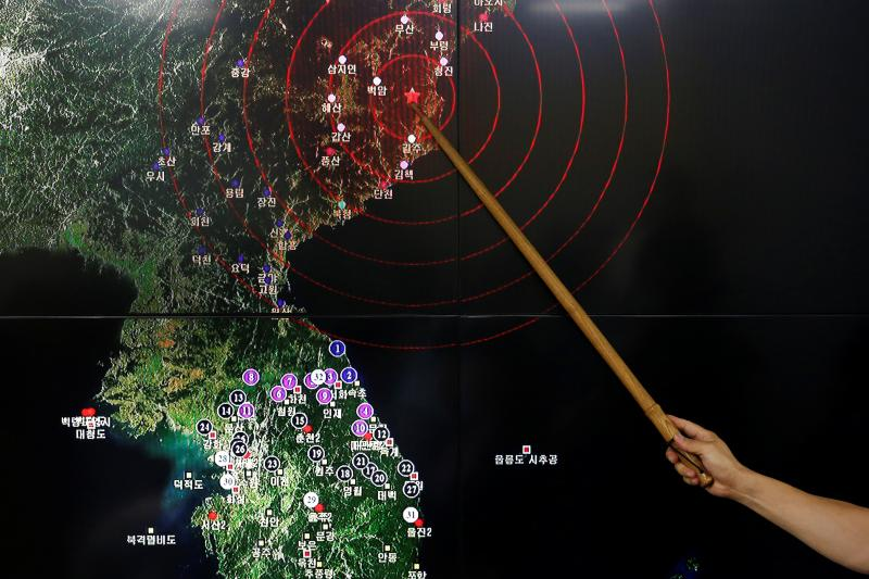 Ryoo Yong-gyu, Earthquake and Volcano Monitoring Division Director, points at where seismic waves observed in South Korea came from, during a media briefing at Korea Meteorological Administration in Seoul, South Korea, September 9, 2016.