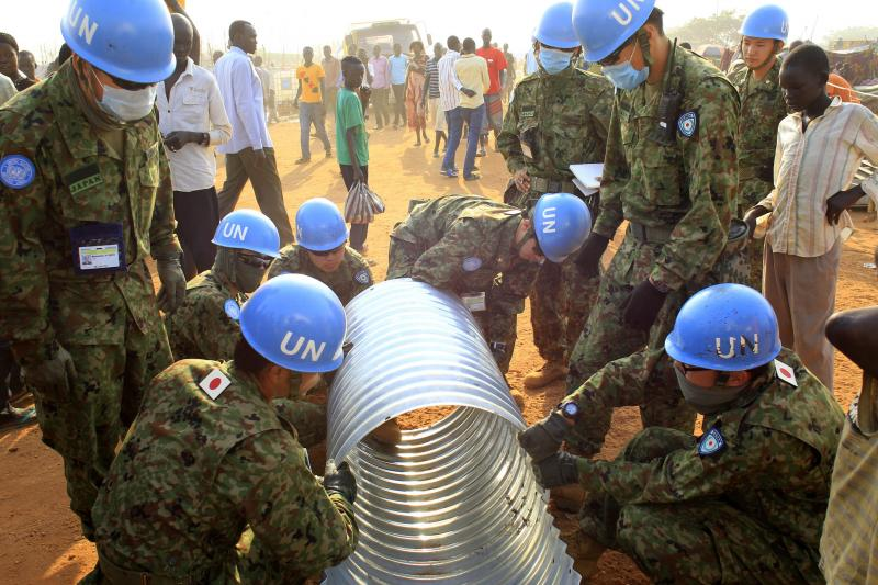 United Nations peacekeepers from Japan working on a drainage pipe in Juba, South Sudan, January 2014.