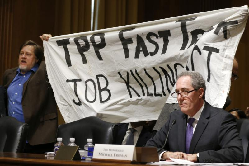 A man protests the TPP at a hearing with U.S. Trade Representative Michael Froman, January 2015.