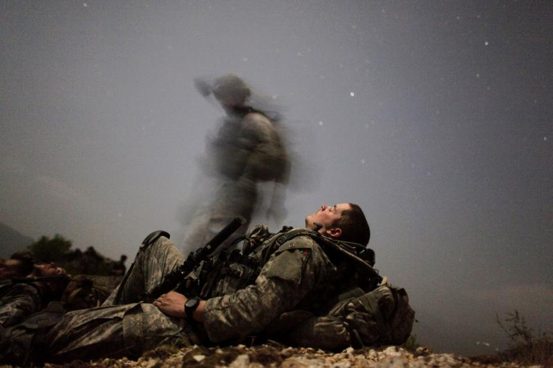 A U.S. soldier of 2-12 Infantry 4BCT-4ID Task Force Mountain Warrior takes a break during a night mission near Honaker Miracle camp at the Pesh valley of Kunar Province in this August 12, 2009 file photo.