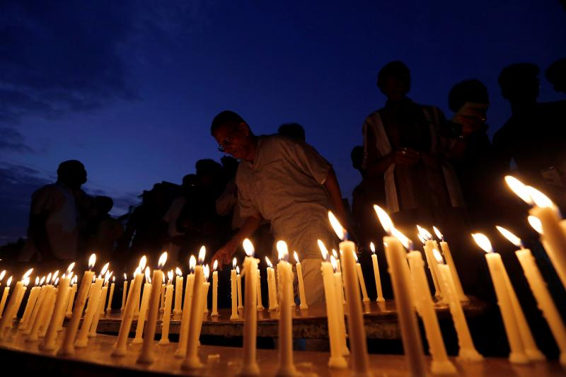 A man lights a candle during a vigil for the soldiers who were killed after gunmen attacked an Indian army base in Kashmir's Uri on Sunday, in Ahmedabad, India, September 22, 2016.