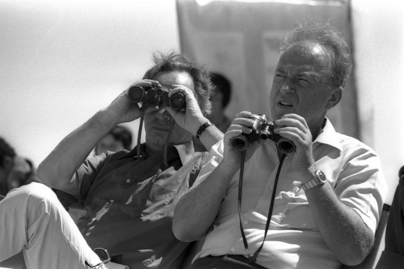 Shimon Peres, then Israel's prime minister, with DefenSe Minister Yitzhak Rabin in the Sinai peninsula, July 1976.