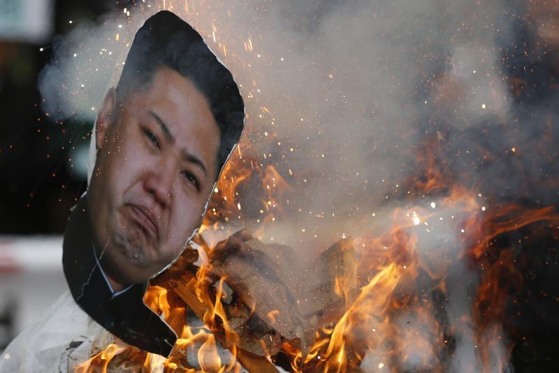 South Koreans burn Kim Jong Un in effigy at an anti-North Korea protest, December 2013.