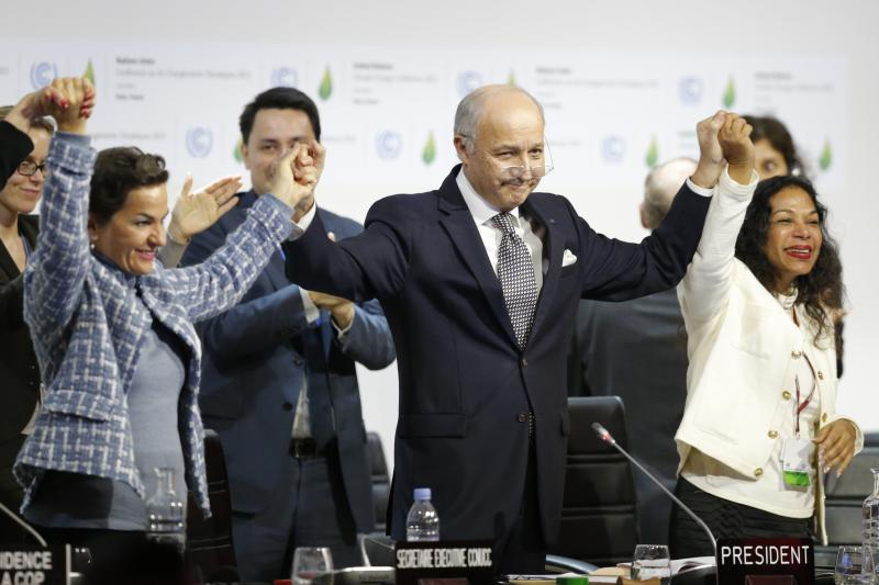 French Foreign Minister Laurent Fabius and UN Climate Change Official Christiana Figueres at the end of the Paris climate talks, December 2015.
