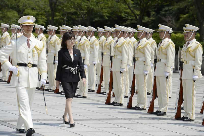Japanese Defense Minister Tomomi Inada reviews an honor guard in Tokyo, August 2016.