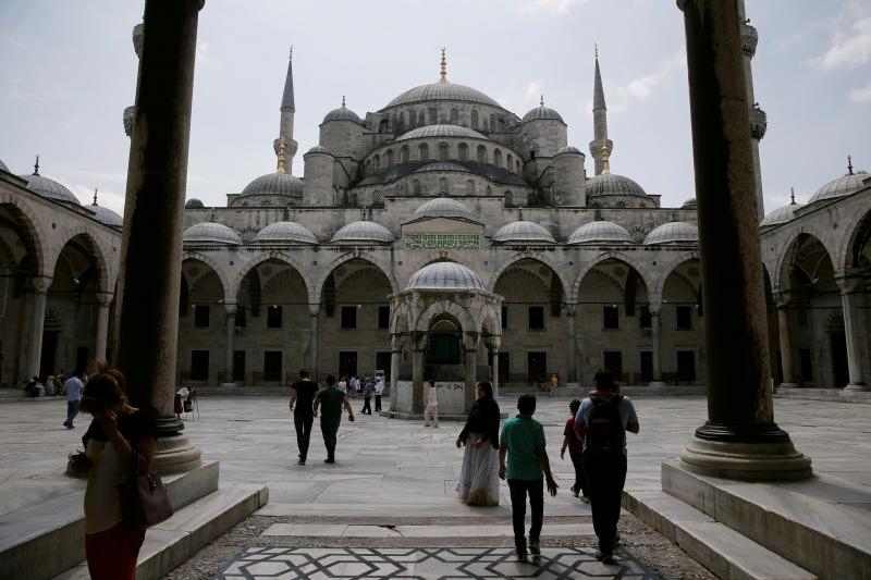 Tourists visit the Ottoman-era Blue Mosque in Istanbul, July 2016.