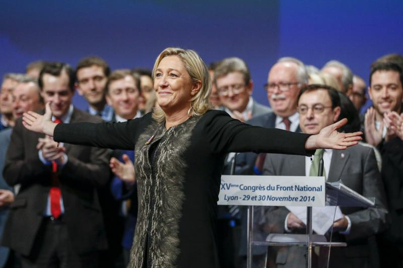 Marine Le Pen reacts to being reelected leader of the far-right National Front, November 2014.