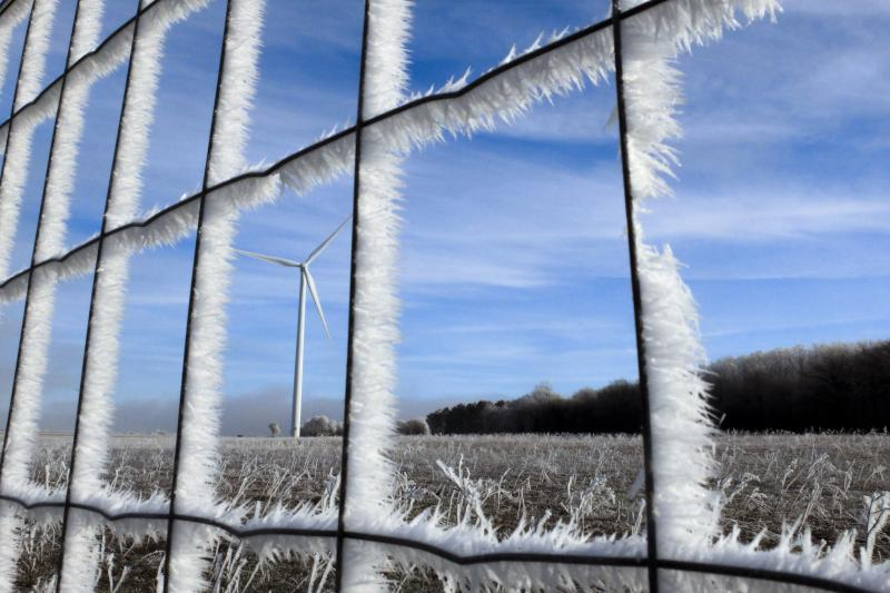 """Fences and fields are covered with frost near the A6 highway, also known as the """"Autoroute du Soleil (Highway of the Sun) near Dijon, France January 6, 2015."""