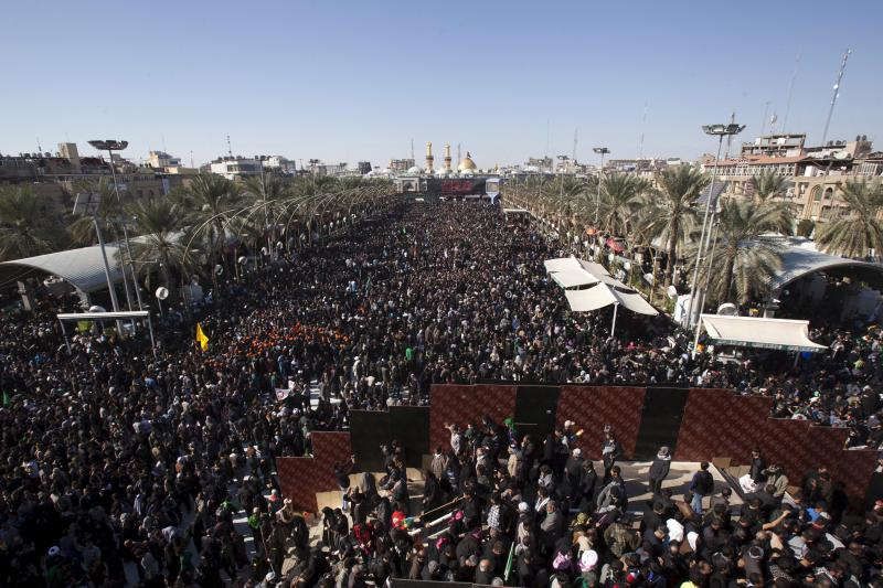 Shiite Muslim pilgrims gather for a religious ceremony to observe Arbaeen in Kerbala, south of Baghdad, December 3, 2015.