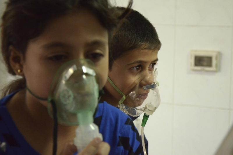 Children, affected by what activists say was a gas attack, breathe through oxygen masks in the Damascus suburb of Saqba, August 21, 2013.