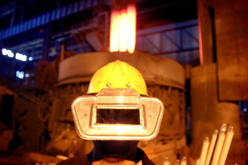 An Iranian worker wears a protection hat at the Steel Saba Complex in Isfahan province 451 km south of Tehran August 12, 2004.