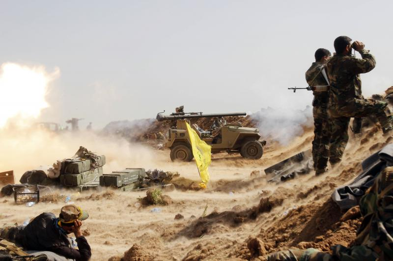 Shiite fighters during clashes with ISIS militants near Kirkuk, March 2015.