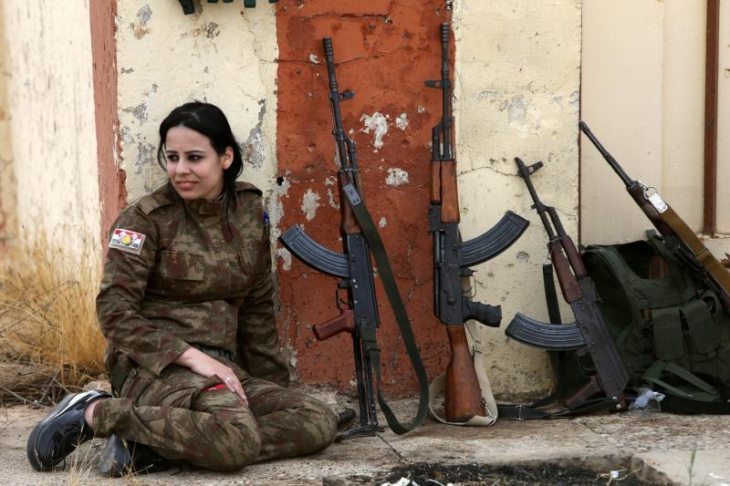 A Yezidi member of the Peshmerga sits in the town of Bashiqa, near Mosul, November 2016.
