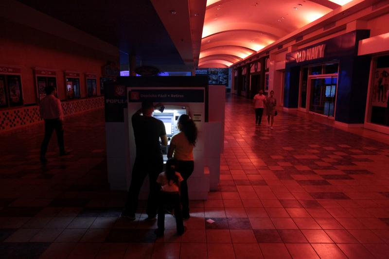 Using an ATM during a power outage in San Juan, Puerto Rico, September 2016.