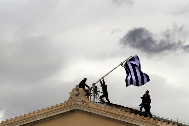 Raising a flag in Athens, April 2012.
