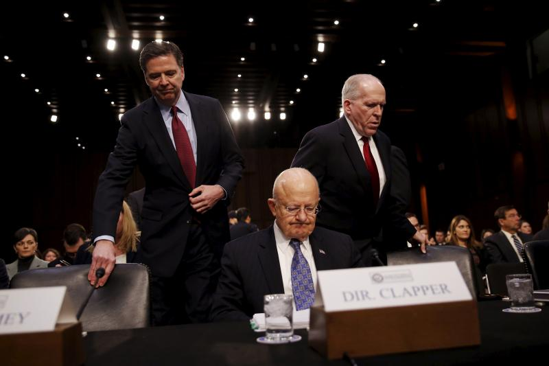 FBI Director James Comey, Director of National Intelligence James Clapper, and CIA Director John Brennan arrive to testify before a Senate Intelligence Committee hearing, Washington, February 2016.