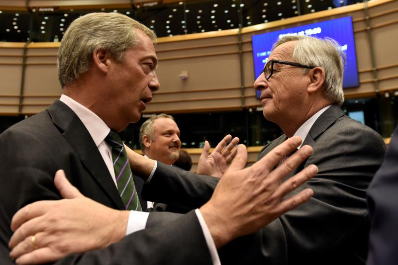 European Commission President Jean-Claude Juncker welcomes Nigel Farage, the leader of the United Kingdom Independence Party, at the European Parliament in Brussels, Belgium, June 2016.
