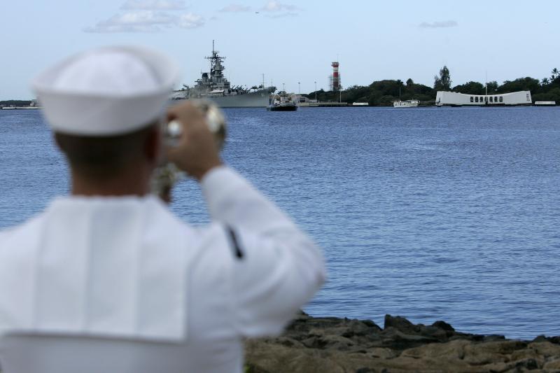 A U.S. Navy seaman plays taps at Pearl Harbor, December 2011.
