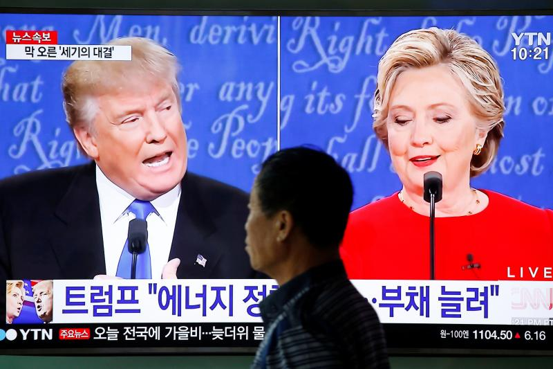A television broadcasts a debate between Hillary Clinton and Donald Trump in Seoul, September 2016.